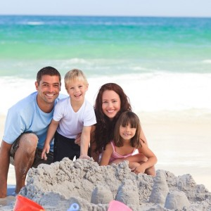Family at beach building sand castle