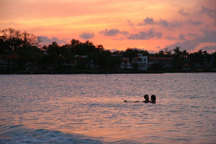 Jamaica: couple swimming together in the ocean
