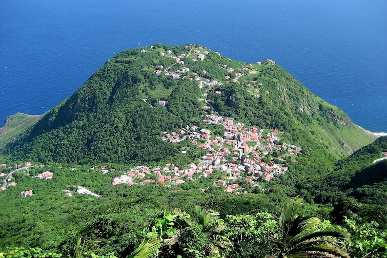 View of the village of Windwardside, taken from Mount Scenery in Saba. Photo Credit: © Radioflux via Wikimedia Commons.