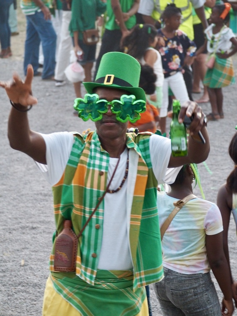 Montserrat: Saint Patrick's Festival - Young man wear Shamrock Glasses. Photo Credit: © Ursula Petula Barzey.