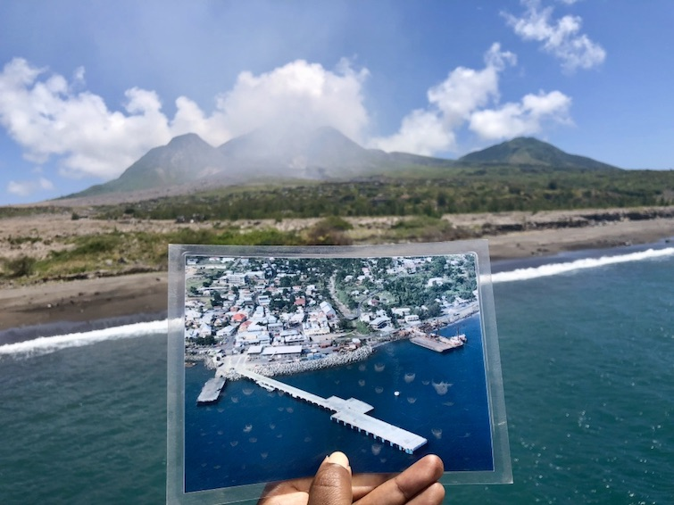 Montserrat: Holding photo of former capital Plymouth loving up at Soufriere Hills Volcano. Photo Credit: © Ursula Petula Barzey.