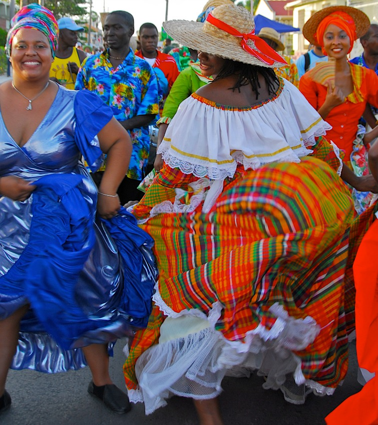 Considering purchasing real estate/luxury home in the Caribbean? Check out our list of 12 reasons why Barbados should be on the shortlist. | Barbados - Dancers during Crop Over Festival.