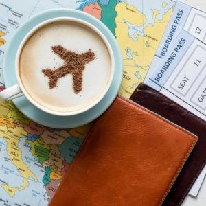 Passports and Boarding passes with Europe map. Photo Credit: © Zinaidasopina112/Adobe Stock.