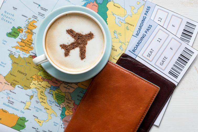 Passports and Boarding passes with Europe map. Photo Credit: © Zinaidasopina112/Adobe Stock.