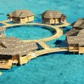 Sandals Royal Caribbean: Overwater Bungalow - Artist Impression Aerial. Photo Credit: ©Sandals Resorts International.