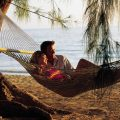 Bahamas: Couple In Hammock On Beach. Photo Credit: ©Bahamas Tourist Office.