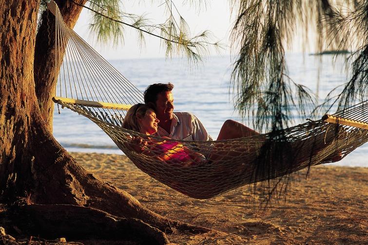 Bahamas: Couple In Hammock On Beach. Photo Credit: ©Bahamas Tourist Office.