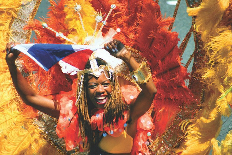 Woman participating in Caribbean carnival. Photo Credit: ©A.C. Gobin/Shutterstock.com.