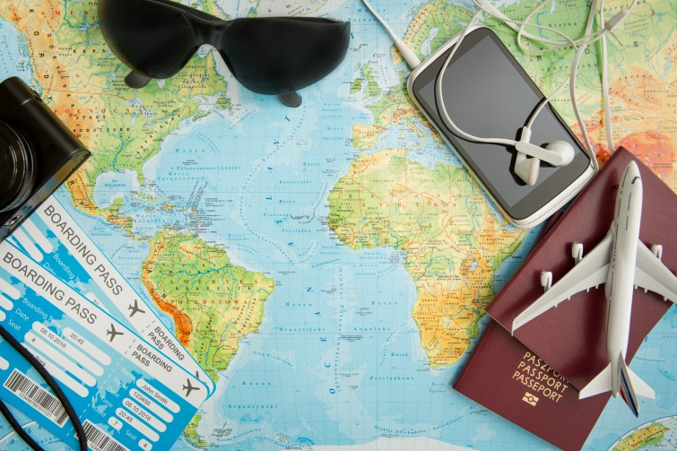 Business travel - traveling map world concept. Photo Credit: © RedPixel/Adobe Stock.