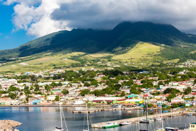 St Kitts: View of harbor and mountains off in the distance. Photo credit: © Abvirago/Adobe Stock.