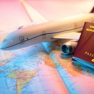 Passport, Airplane and Map of World