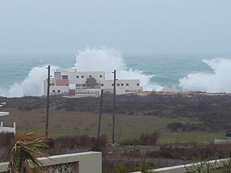 Anguilla: Waves crashing into houses along coastline from Hurricane Irma.