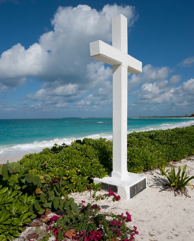 Bahamas: A simple white cross in Long Bay to commemorate the first Caribbean land sighted by Christopher Columbus on his first voyage in 1942. Photo Credit: © Bahamas Ministry of Tourism.