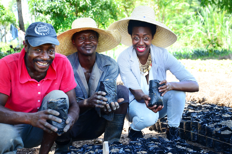 Kreyol Essence founder Yve-Car Momperousse with Haitian farmers.