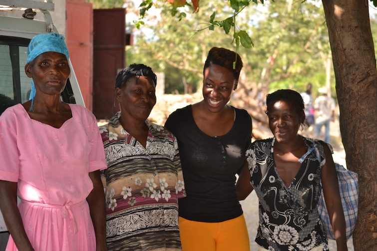Kreyol Essence founder Yve-Car Momperousse with women Haitian farmers.