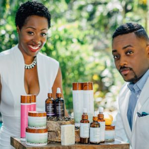 Kreyol Essence founders YveCar Momperousse and Stephane Jean-Baptiste with hair and beauty products.