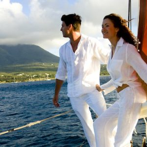 Couple on sailboat near St Kitts & Nevis. Photo Credit: © Nevis Tourism Authority.