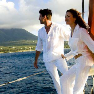 Couple on sailboat near St Kitts & Nevis. Photo Credit: © Nevis Tourism Authority.