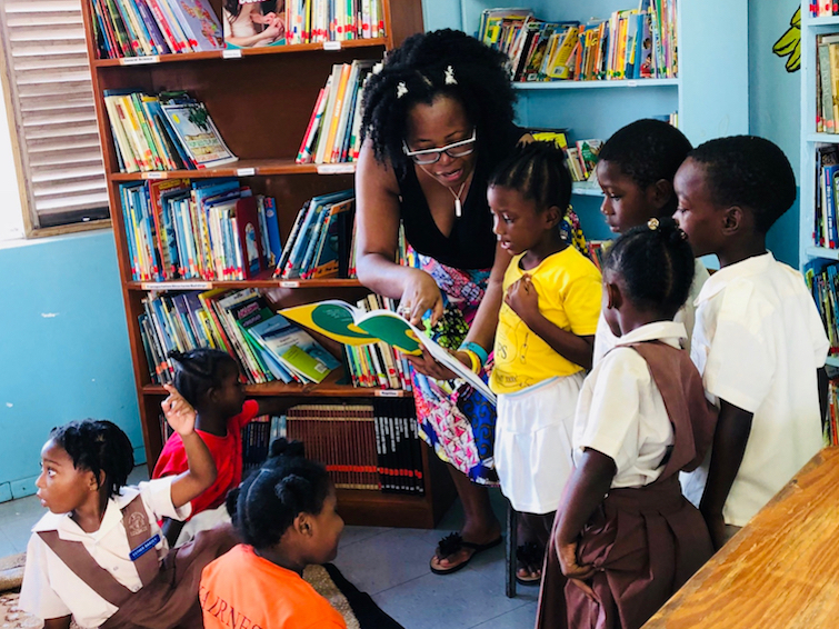 Sandals Foundation in Antigua: Scholastic Reading Road Trip - Reading to students at Villa Primary School.