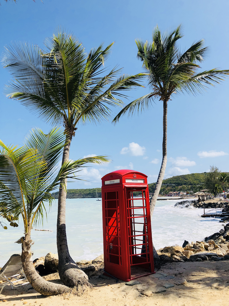 Sandals Grande Antigua Resort & Spa: Panoramic view of Dickenson Bay Beach - Red telephone box.