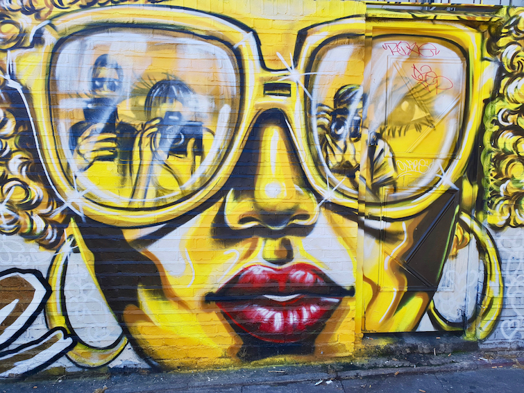 African Caribbean Street Art in London: Mural by Carleen De Sozer and Candie Bandita titled Living Life Like It's Golden.
