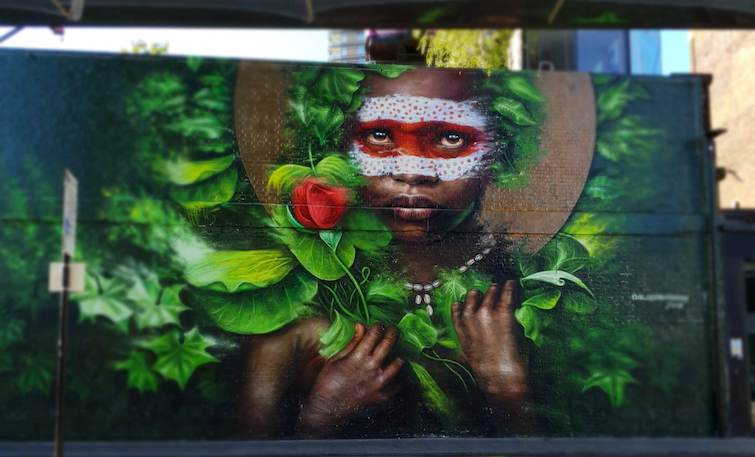 African Caribbean Street Art in London: Dale Grimshaw Mural of little Ethiopian girl.