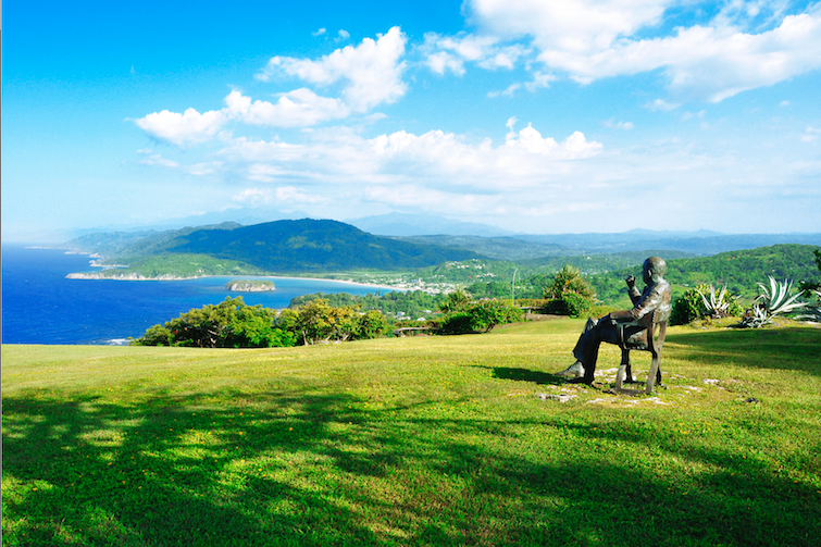 Jamaica: View of Caribbean sea and statue of Noel Coward by Angela Conner in front of Firefly Estate. Photo Credit: © Jamaica Tourist Board.