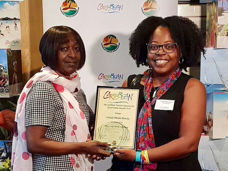 CTO Caribbean Travel Media Awards: Ursula Petula Barzey receiving Best Social Media Campaign for work on #NextStopGrenada. Presenting: Barbara Mercury, Director of Sales UK / Europe, St.Vincent and the Grenadines Tourist Office.