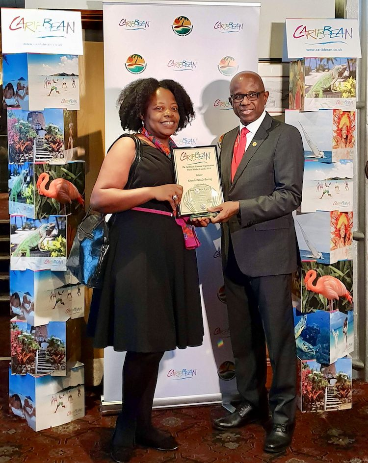 CTO 2018 Caribbean Travel Media Awards: Ursula Petula Barzey receiving Best Caribbean RoundUp for 10 Facts About The Caribbean Region blog post. Presenting is Hugh Riley, Secretary General, Caribbean Tourism Organization.