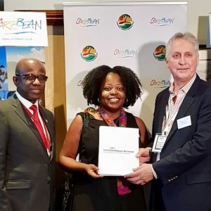 CTO 2018 Caribbean Travel Media Awards: Ursula Petula Barzey receiving Best of the Best Award. Presenting: Hugh Riley, Secretary General, Caribbean Tourism Organization and Trevor Sadler, CEO, InterCaribbean Airways.