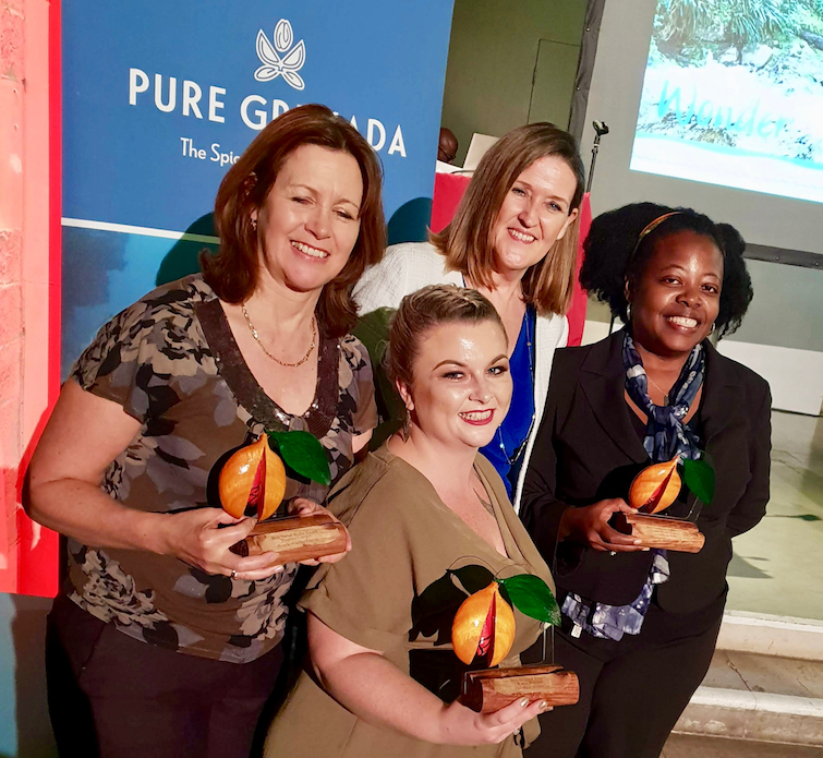 Grenada Tourism Authority CEO (white jacket) with L-R Heather Cowper, Kacie Morgan and Ursula Barzey whose excellence in digital and social media was recognized at the Pure Grenada Recognition of Excellence and Cultural Delight.
