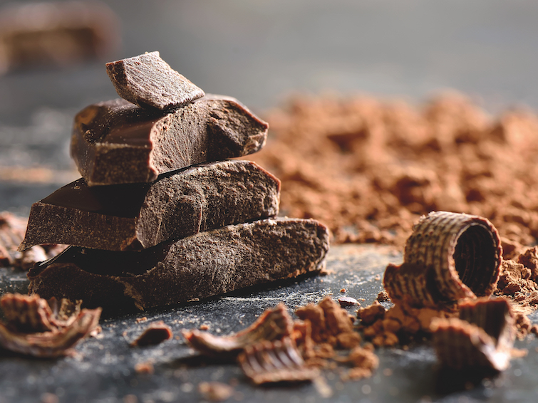 Dark chocolate stack chips and powder. Photo Credit: Shutterstock via Caribbean Export Development Agency.