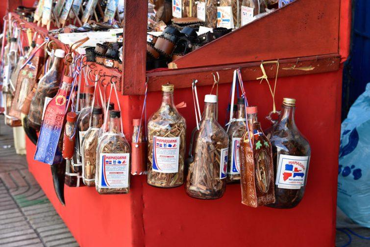 Bottles of Mamajuana drink sold as souvenirs. Photo Credit: © Giuseppe Crimeni via 123rF.com.