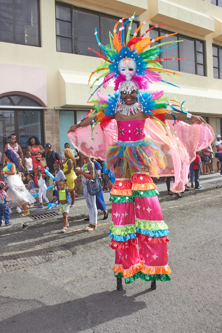 Antigua Carnival: Stilt Walker. Photo Credit: © Antigua Barbuda Festival Commission.