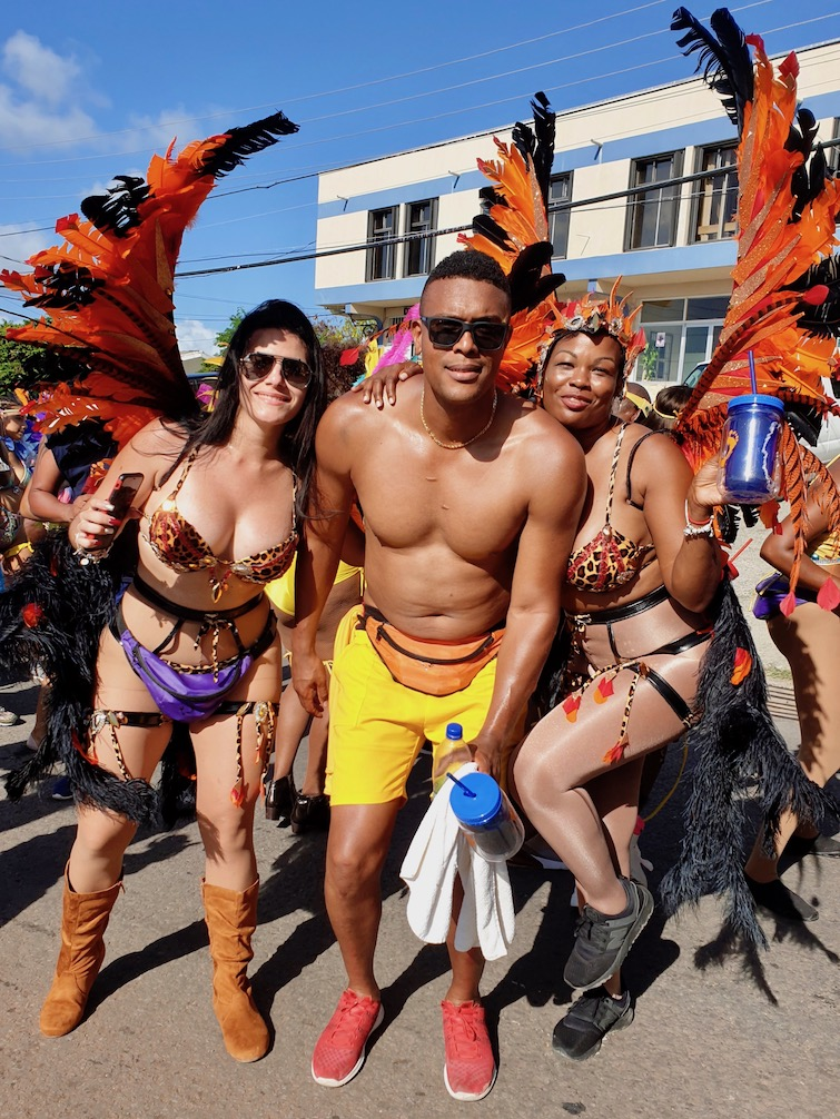 Three revelers at Antigua Carnival.