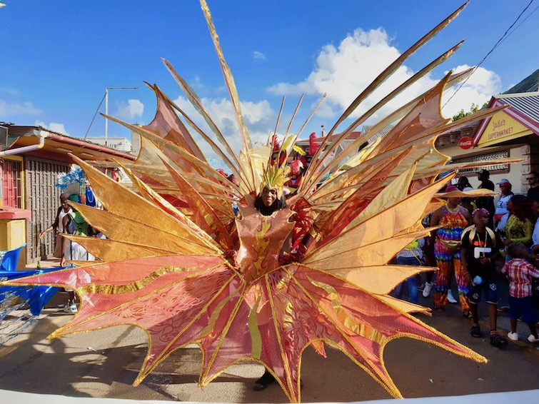 Young girl in traditional fish theme costume at Antigua Carnival.