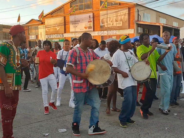 Drummers walking through the crowd in Vieux Fort, part of the Creole Day in St Lucia celebrations.