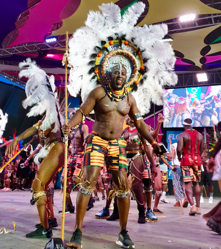 Kente Africa masquerader with Insane Mas Band at Antigua Carnival 2019.