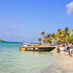 Group of people near Captain Neil boat on Petit Bateau, Tobago Cays Marine Park, Saint Vincent & The Grenadines.