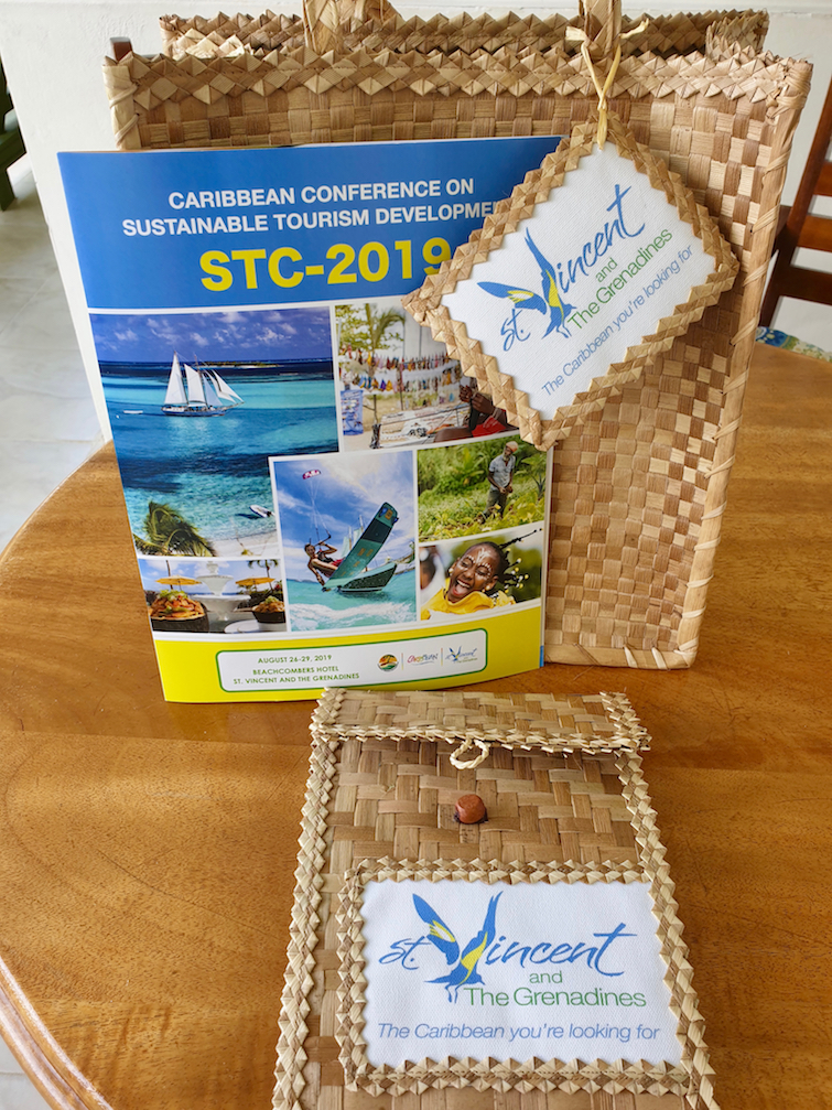 Traditional straw bag with 2019 Caribbean Conference on Sustainable Tourism Development program.