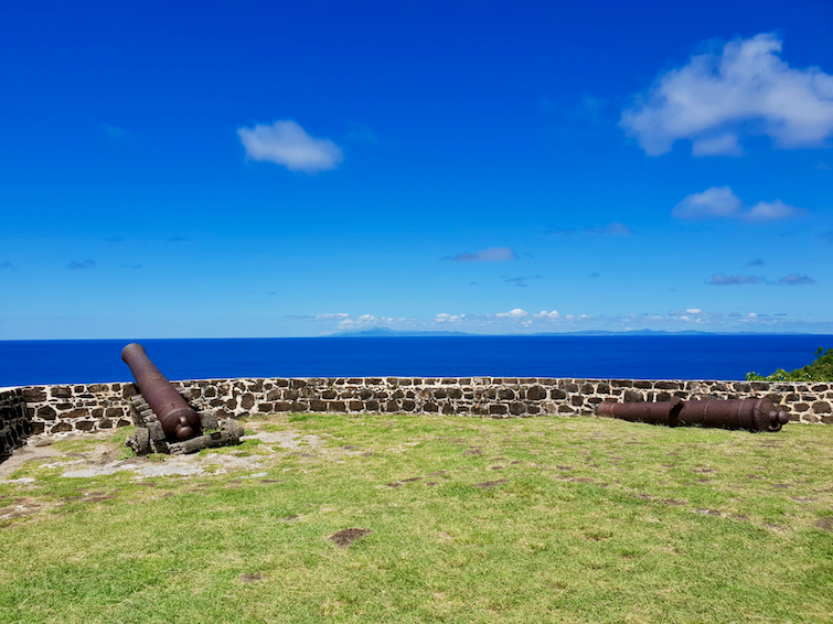 Cannons on Fort Rodney and a view of Martinique off in distance from Pigeon Island in St Lucia.