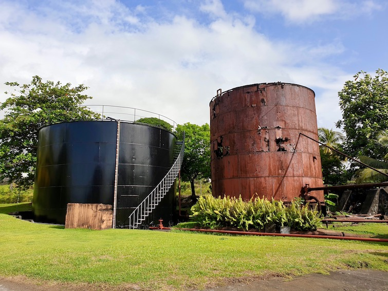 Old and new storage tanks for molasses at St Vincent Distillers Ltd.