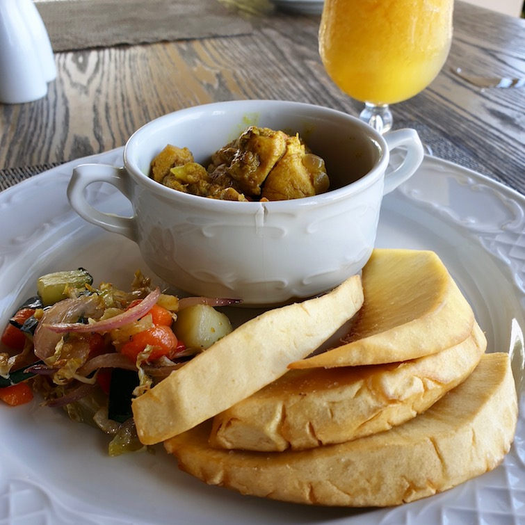 Roast breadfruit with curry chicken from restaurant at Zoetry Montego Bay in Jamaica.