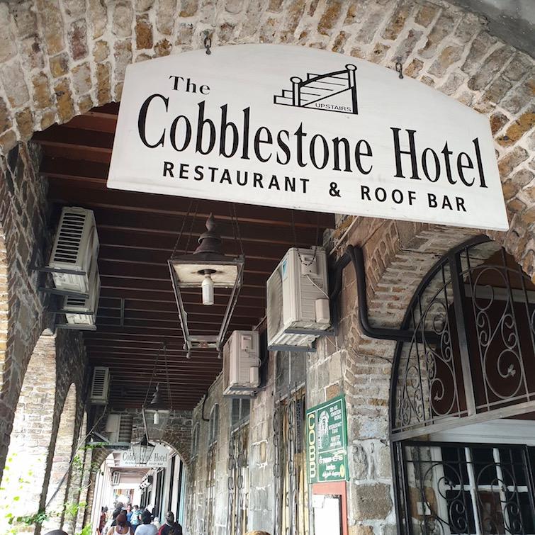Sign for Cobblestone Inn Restaurant and Roof Bar in Kingstown, St Vincent.
