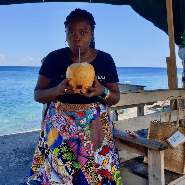 UB drinking coconut from Kingstown Public Market, St Vincent.