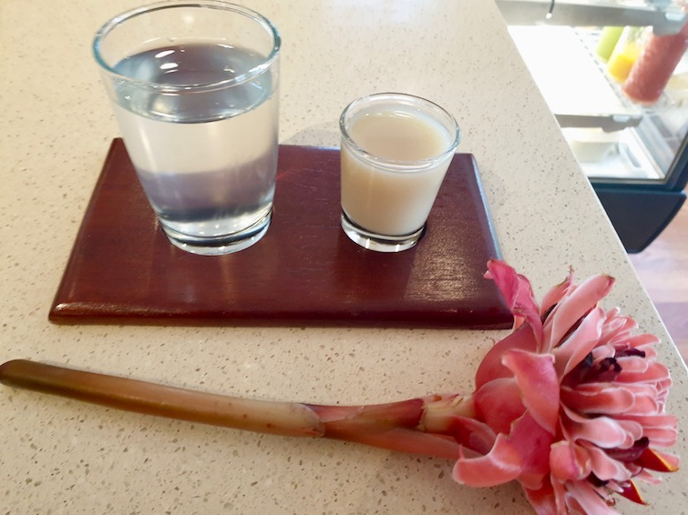 Ginger juice shot with coconut water at Ital Cafe, Half Moon Jamaica.