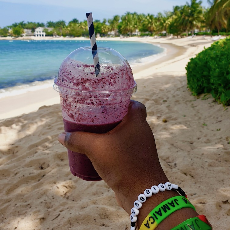 UPB having a berry smoothie on Sunset Beach at Half Moon Jamaica.