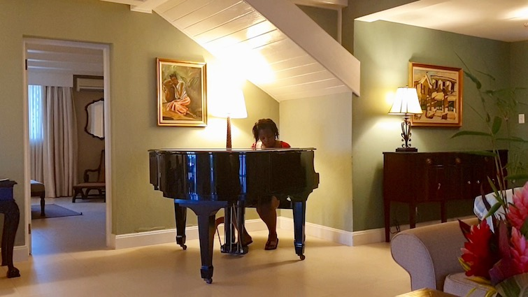 UPB playing baby grand piano in West Cottages 1015, Founders Cove at Half Moon Jamaica.