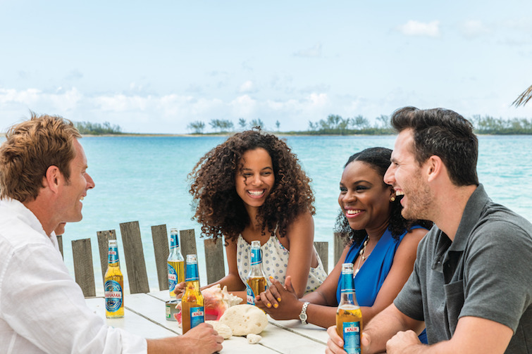 Friends enjoying a fish fry in The Bahamas. Photo Credit: © Bahamas Ministry Of Tourism.