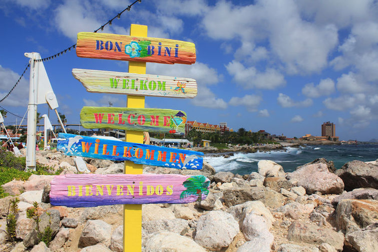 Welcome signs in different languages in Willemstad cruise port, Curacao, Caribbean island. Photo Credit: © Malgorzata Slusarczyk via 123RF.com.